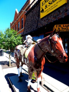 A Babies' First Trip to Steamboat | Riding on Lighting the Horse Outside F.M. Light and Sons in Steamboat Springs, CO | Western Wear for Over 100 Years