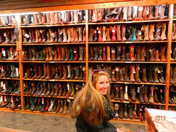 Pictures from Merrie - Customer in F.M. Light and Sons admiring the boot wall full of cowboy boots in Steamboat Springs, CO