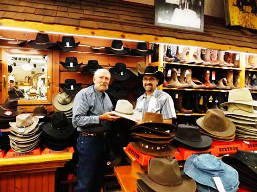 John Fischer (of the Yampa Valley Boys) recieves his hat from Del Lockhart, in a drawing offered by F.M. Light and Sons and Stetson | Western Wear in Colorado