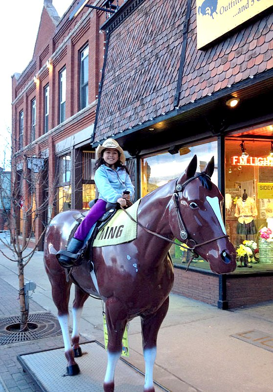 Jillian B on Lightning outside F.M. Light and Sons in Steamboat Springs, CO - Western Wear for Over 100 Years