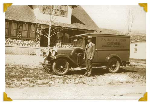 Clarence Light Standing Beside his Store on Wheels Used During the Depression| F.M. Light and Sons, Western Wear in Steamboat Springs, CO | Historical Photo, 1928
